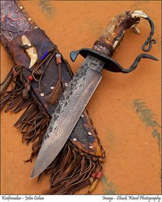 This big damascus Bowie was the first I made like this using a lower bear jaw for the handle scales and a long curl off of the wrought iron frame that forms part of the D Guard. Cool Knives, Knives And Swords, Types Of Knives, Dagger Knife, Iron Steel, Knife Sheath, Mountain Man, Custom Knives, Knife Making