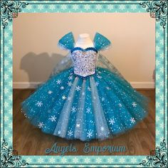 Excited to share this item from my shop: The Snow Queen Frozen Princess Inspired Tutu Dress Elsa Costume Pageant Ball Gown Ice Blue White Snowflake Dress With Long Cape Snowflake Dress, White Snowflake, New Cinderella, Frozen Themed Birthday Party, Snow Dress, Frozen Elsa Dress, Frozen Princess, Princess Tiana, Princess Ball Gowns