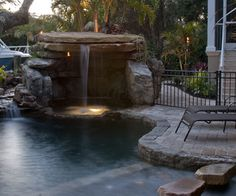There may be something about moving water that soothes the soul. Paying attention to the splash of a backyard fountain or watching the sunshine play off ripples is universally calming. Grotto Pool, Lagoon Pool, Hot Tub Backyard, Ponds Backyard, Backyard Waterfalls, Backyard Ideas, Tropical Landscaping, Backyard Landscaping, Pool Remodel