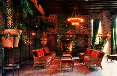 nonfussy chandelier; lots of plants; benches; wood ceiling and brick walls
