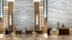 Capsule Arts's recently completed commission by Giles Miller Studio for the Lobby of Kempinski Hotel Mall of the Emirates in the UAE. Thousands of bronze-finish box elements of varying depth, colour and transparency were hung cascading down the face of the reception feature wall. When viewed from afar, a pattern emerges.