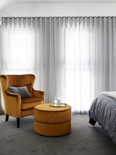 Gray bedroom with yellow armchair and ottoman | Usual House