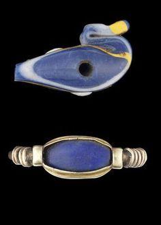 An Egyptian glass duck bead and a lapis lazuli scaraboid ~ New Kingdom ~ 1550-1070 B.C.