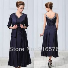 Love Navy dress with crystal beading at the neck line and accompanying jacket.