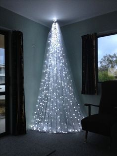 Top 6 Alternative Christmas Tree Ideas - DIAMOND INTERIORS - - Short on space? Try these stunning alternative Christmas tree ideas to WOW this Christmas! Different Christmas Trees, Wall Christmas Tree, Creative Christmas Trees, Diy Christmas Lights, Decorating With Christmas Lights, Beautiful Christmas Trees, Modern Christmas, Simple Christmas, Christmas Home
