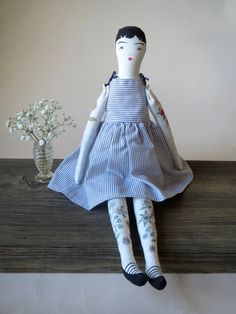 Order a doll like this one and I will be happy to take into consideration specific requests and suggestions to personalize your doll.  This little doll is completely hand sewn from soft cotton and painted with delicate details from her ruby red lips to black strappy shoes, and is covered with tattooed flowers. She is approximately 19 tall and sits up nicely with a little help. Her arms move up and down and are secured with tiny vintage glass buttons on each arm. She is a completely one of a…