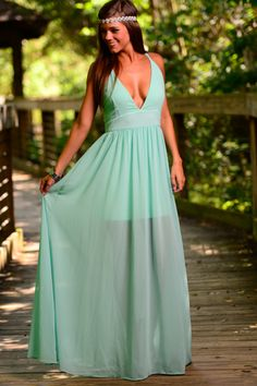 This gorgeous mint maxi is beautiful!! Don't mind when people stare because you will look stunning in this maxi! The low v neckline and the open back is just plain fabulous!