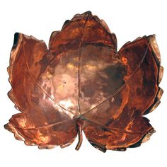 A beautifully rendered American hand-wrought copper maple leaf-form bowl by Alfredo Sciarrotta b. 1907 d. the well-crafted leaf of thick copper with fine veining and curled edges raised on a cluster of rings. Copper Crafts, Copper Decor, Leaf Crafts, Copper Art, Decorative Objects, Decorative Bowls, Thanksgiving Projects, Leaf Bowls, Copper Sheets