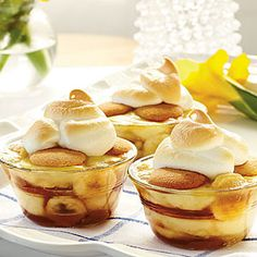 Caramelized Banana Pudding: ingredients - 1/2 cup firmly packed light brown sugar; 1/4 cup butter; 1/4 teaspoon ground cinnamon; 4 large ripe bananas, sliced; 1 cup granulated sugar, divided; 1/3 cup all-purpose flour; 2 large eggs; 2 cups milk; 4 large eggs, separated; 2 teaspoons vanilla extract; 48 vanilla wafers