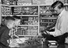 Into the mid 1950's we see what a Hobby Shop looked like. Firebaby is on counter and shelf. Also, notice the late model Fireball on the top shelf. On the far lower right is a box of '74 Fighters.
