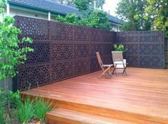 Wooden decking with metal decorative screening