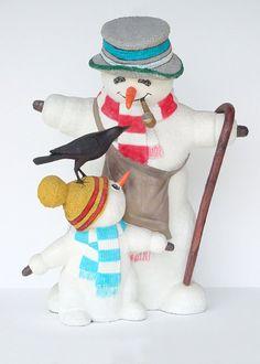 Grote en kleine sneeuwpop