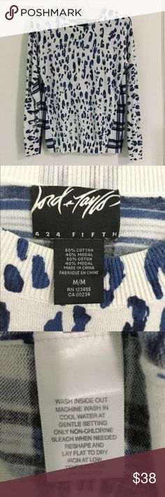 Lord & Taylor 424 Fifth Leopard Plaid Knit Sweater Lord & Taylor top is a classic crew neck pullover style knit sweater. It has a white background with leopard or cheetah spots in a rich blue hue with black details. The back of the sweater has a plaid design making this a pattern mixing statement piece. Comfortable soft cotton modal (rayon) blend with Lord and Taylor's impeccable quality combine to make this one of your closet staples. Wear alone or layer it on cooler days. Timeless, classic…