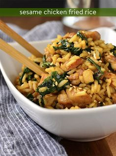 Sesame Chicken Fried Rice is much healthier then take out! With a fraction of the oil, but all the flavor of your favorite Chinese food order, this gluten-free dinner recipe will be a hit with even the pickiest of eaters.| iowagirleats.com
