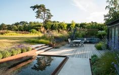 Lines in the Landscape - Modern garden of strong lines and bold shapes in Kent. We are country garden designers & Masterplanners. Landscape Materials, Landscape Design, Garden Design, Back Gardens, Outdoor Gardens, Garden Paths, Garden Bridge, Sloped Garden, Garden Cottage