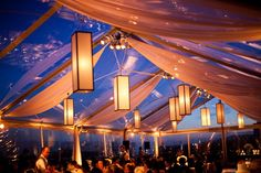 This is really cool. Long lanterns and sashes in tent