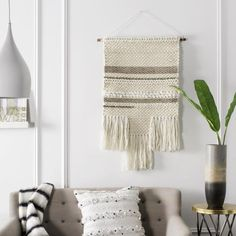 Designed for the contemporary tastemaker, this woven wall art boasts minimalist Nordic style. #lowes #ivory #beige #livingroom #texture