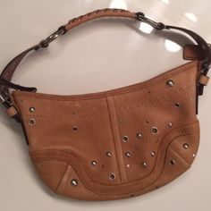 Coach Tan Leather Handbag with Silver Detail! This beautiful tan leather Coach bag is 100% authentic! The bag features gold detail! The bag has silver metal detail! This leather is in excellent condition!!!!!! This bag will NOT last long! This is the perfect handbag for any occasion!! The inside is clean as well! ❤️❤️ Coach Bags Shoulder Bags