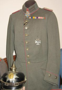 Imperial German officer's WWI pickelhaube helmet and uniform tunic, bearing decorations that include the Pour le Merite  and Iron Cross.