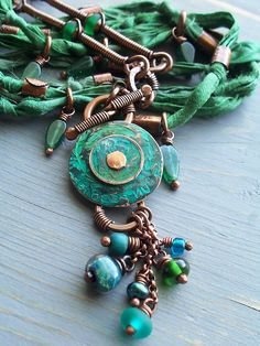 The Cerebral Dilettante: Jungle Love - recycled sari ribbon, patinated coins, copper tubing beads, wire-wrapped bars, etc.