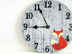 A cute woodland themed fox wall clock that\'s just perfect for a rustic nursery. Great baby shower gift, too! This unique wall clock is hand made by us using an old 12 vinyl record, artwork and a battery operated quartz clock movement. The face is finished with a clear lacquer to protect the