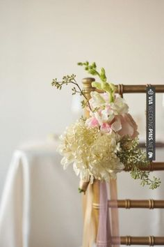 Cool! - flowers on chair | CHECK OUT MORE GREAT VINTAGE WEDDING IDEAS AT WEDDINGPINS.NET | #weddings #vintagewedding #weddingvintage #oldweddingphotos #events #forweddings #iloveweddings #romance #vintage #planners #old #ceremonyphotos #weddingphotos #weddingpictures