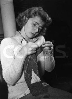 19 Dec 1941 --- Almost all Wells students are knitting for the Red Cross or for Bundles for Bluejackets, for military support efforts. Here Isabel Ford of Youngstown, Ohio, drops a stitch as she works on an exacting knitting job. --- Image by ? Bettmann/CORBIS