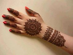 Bridal henna or mehndi designs for hand. Bridal manicure.