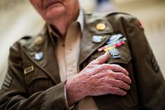 Friday, June 5: The Legion of Honor       World War II veteran Robert Harris, 90, of Fort Valley, Ga., 2015  places his hand on his chest during the singing of the national anthem at a ceremony where Harris and
