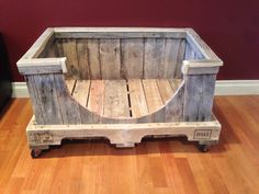 Pallet dog bed frame with wheels on the bottom also