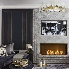 This is such a chic & sleek living room! I love the chandelier & fireplace combination. It's just so modern & epic. It really makes this living room fun & exciting!