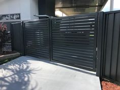 Aluminium slated feature gate with colourbond fence by Brisbane landscapers Instant Greenscene
