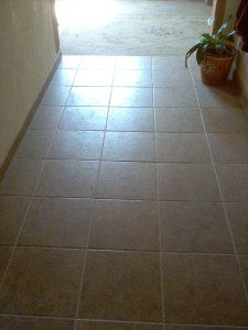 Our partially tiled floor! #tile #construction #remodeling #floor