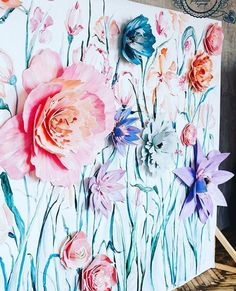 Paper flowers and paint photo wall.