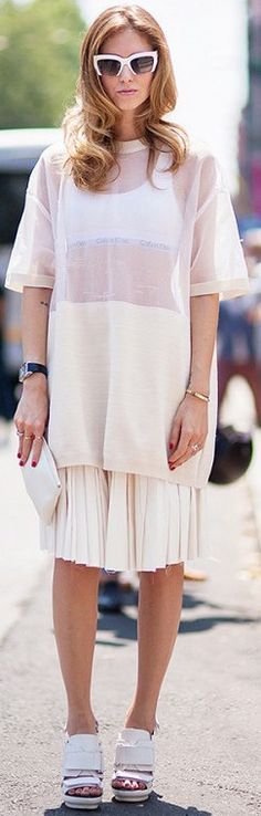Chiara Ferragni of The Blonde Salad wearing a sheer tunic and a pleated skirt