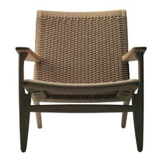One+of+the+earliest+models+by+Danish+designer+Hans+J.+Wegner,+the+CH25+low+armchair+was+constructed+in+1950+and+is+now+considered+a+classic+example+of+mid-century+modern+design. The+armchair+is+hand-woven+using+a+distinctive+pattern+that+requires+more+than+400+metres+of+paper+cord.+It+takes+a+trained+craftsman+8-10+hours+to+complete+a+single+chair.…
