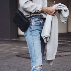 Loving the fadded high waist jean, ripped knee and the classic Chanel handbag. High/low at its best.