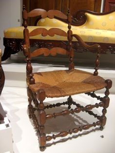 "1775-1800 French Canadian Armchair at the Royal Ontario Museum, Toronto - From the curators' comments: ""The term, à la capucine, or in the Capuchin style, is applied to chairs with double-looped, horizontal back slats. Essentially a ladder-back chair, it was a common, everyday type and usually had a rush or straw seat. Ultimately of French derivation, the general type continued to be made in the rural areas of Quebec well into the 19th century."""