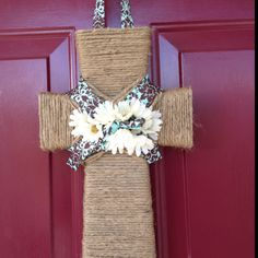 Door hanger using a wooden cross from a craft store.