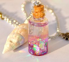 Beautiful pendant in a glass bottle. In a small bottle there is a reproduction of a very small goldfish. Bottle Jewelry, Bottle Charms, Resin Charms, Bottle Necklace, Little Mermaid Crafts, Crafts With Glass Jars, Magic Bottles, Small Glass Bottles, Doll House Crafts