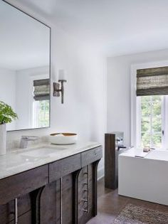 Master Bathroom with Wall sconce by Michael Abraham Architecture   Zillow Digs