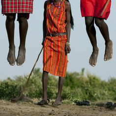 Masai warriors jumping during a dance - Kenya by Eric Lafforgue