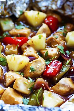Grilled Pineapple Chicken Foil Packets - chicken, pineapple, peppers, and onions slathered in a sweet and savory teriyaki sauce and cooked on the grill!