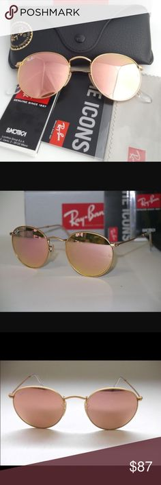 Ray-Ban authentic round metal pink flash 50mm B R A N D  N E W  ~  1 0 0 %  AUTHENTIC  R E G U L A R  P R I C E :  $ 1 7 0    Brand new, authentic Ray-Ban sunglasses,   come with original box, case and cleaning cloth.    Model: RB3447 112/Z2  Frame Color: Gold  Lens Color: Brown Mirror Pink    Style: Round  Frame material: Metal  Lens material: Crystal Ray-Ban Accessories Sunglasses