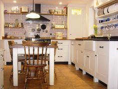A lovely photo of a customers kitchen with the Richardson Pendant hanging over the table