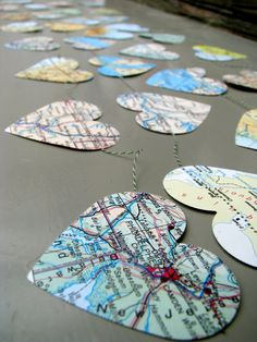 MAP PAPER GARLAND-could make it maps of places you've been with your family for the christmas tree Bridal Shower Decorations, Wedding Decorations, Map Decorations, Wedding Ideas, Decor Wedding, Wedding Themes, Rustic Wedding, Wedding Ceremony, Travel Nursery
