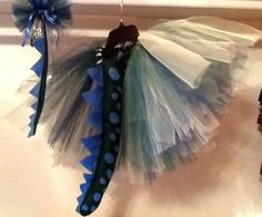My niece requested a dinosaur tutu skirt haha! This is what I came up with. The tail can be worn separate and a hair bow with tail. What fun!!