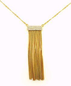 Colar com franjas banhado a ouro 18 k, contém aplicações de cristais.