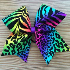 A personal favorite from my Etsy shop https://www.etsy.com/listing/234349969/neon-rainbow-cheetah-zebra-cheer-bow