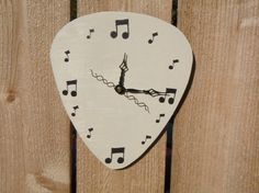 My guitar-playing hubby would love this clock!